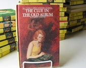 Listing CC: 1977, hard cover, Nancy Drew book, no. 24, The Clue in the Old Album. photos, mystery, solve it, pop culture