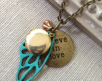 Believe in Love brass locket with Wing Charm and Flower Necklace . Antique brass . Whimsical magic pendant charm