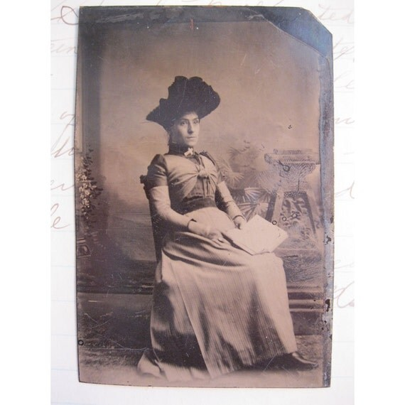 tintype photo - seated WOMAN with hat holding book - ferrotype, late 1800s - TT101