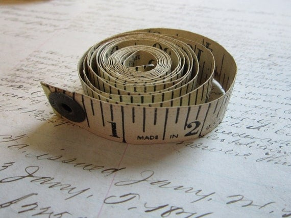 vintage tape measure - vinylized fabric - white with black numbers and snap end - 60 inches