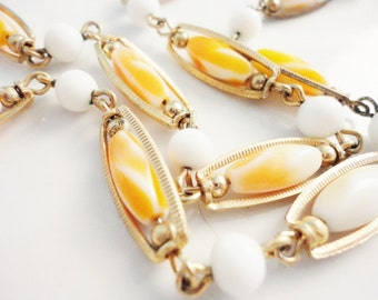 vintage double strand necklace orange and white glass beads gold tone