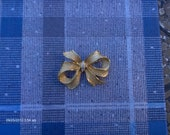 Shiny Goldtone Bow Brooch with Rhinestones - Lovely