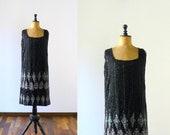 Vintage beaded black dress. 1960s does 20s dress. rhinestones beads flapper dress