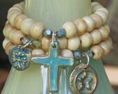 bone bracelet set with bronze charms with patina...