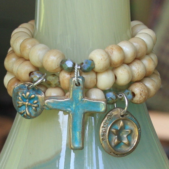bone bracelet set with bronze charms with patina...