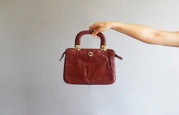 oxblood etienne aigner handbag