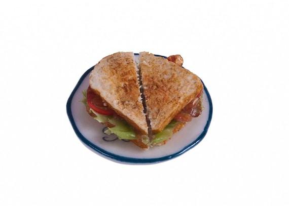 BLT toasted  sandwiches miniature food