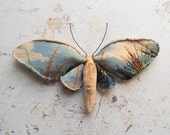Moth made from vintage hand embroidered tapestry.Textile art.