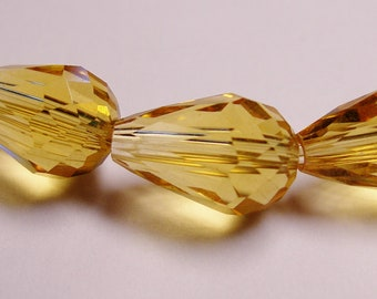 Faceted teardrop crystal  beads 12 pcs 14mm by 9mm - amber