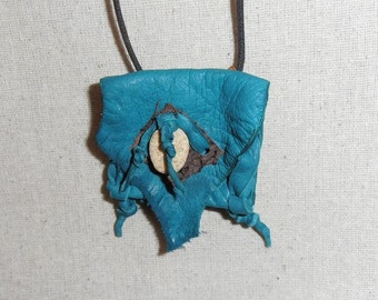 Pond- This Wisdom Pouch is made out of Turquoise colored Deerskin leather and features a piece of Brown Fish Hide leather and a Beach Stone