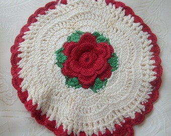 Hand crocheted hot pad or wall decoration with small loop for hanging.