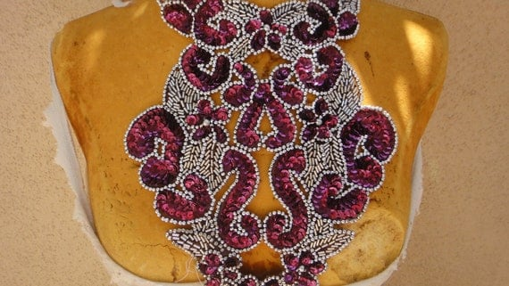 Nice  embroidered  and beaded  applique with sequins