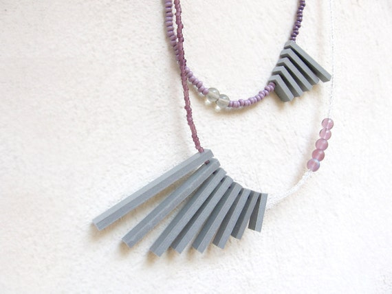 double geometric necklace with grey sticks and purple beads