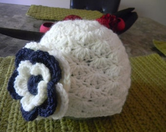 Baby girl beanie with a navy blue and white flower, antique white