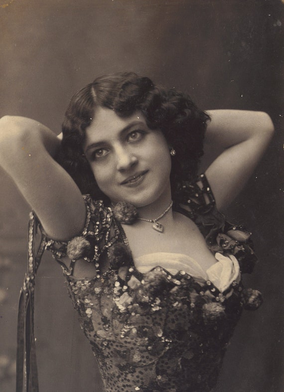 Dark Beauty in Sequins and Pom-Poms circa 1907