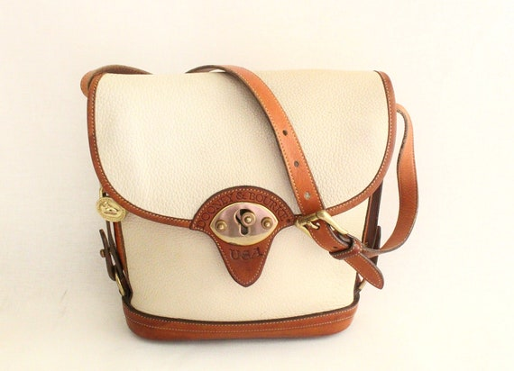Dooney and Bourke Cream Pebble leather and tan color leather trim  Cross Body Shoulder Bag.