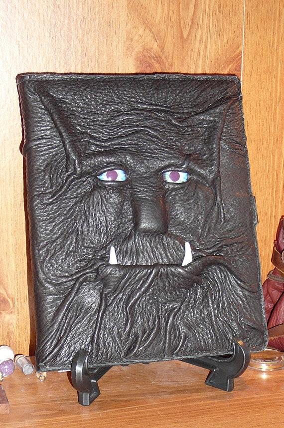 Dragon eyed iPad Cover (aqua eyes) black leather tusks and buckle closure