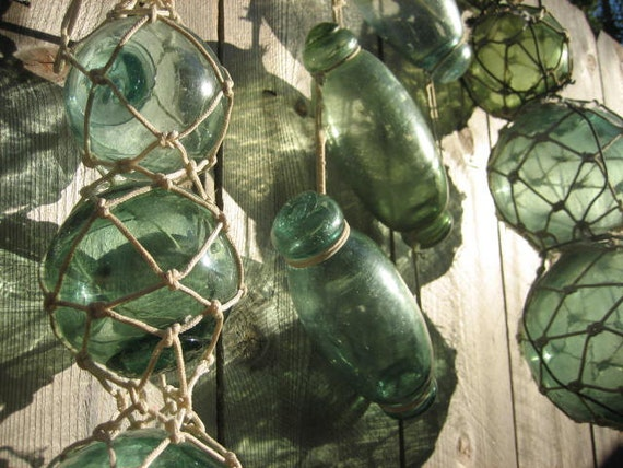 Collection of 12 Handblown Japanese Glass Fishing Buoys / Floats -- Green Mid Century Rollers & Spheres, with Macrame for Hanging