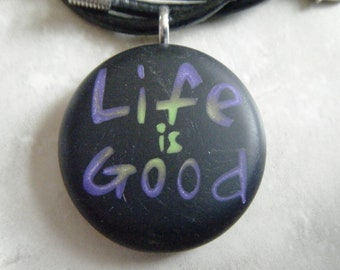 Life Is Good hand carved on a polymer clay black color background. Pendant comes with a FREE necklace