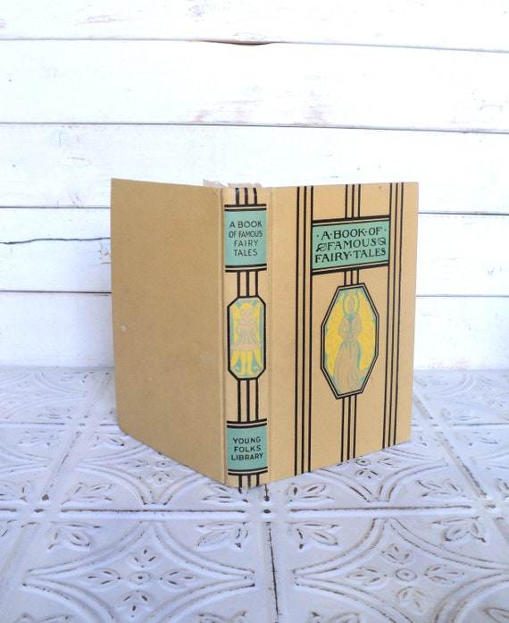 A Book of Famous Fairy tales Young Folks Library Aqua, Beige, Tan, Black, Yellow 1953