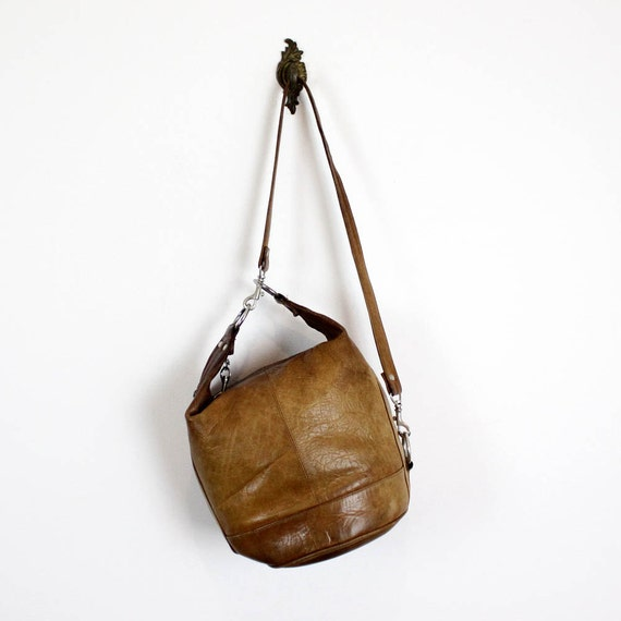 distressed brown leather bucket bag
