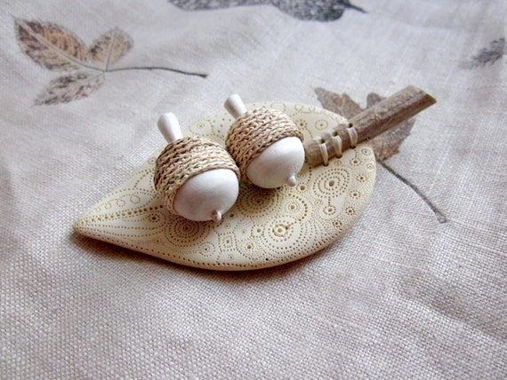 Hand sculpted acorns with a unique leaf bowl