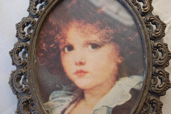 Vintage oval ornate brass picture frame