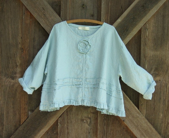 linen top flare with ruffle, tucking and a rose in light blue