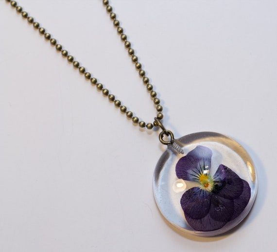 Clear Resin Pendant necklace real dried viola violet flower
