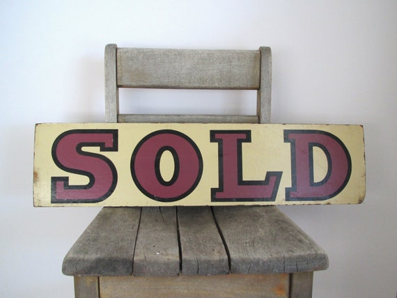 Vintage sign......SOLD.........tan with purple lettering........hand painted.