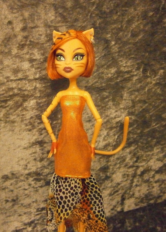 Slinky orange and animal print dress for monster high dolls