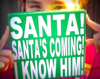 Santas Coming I Know Him Green and White Painted Wood Sign