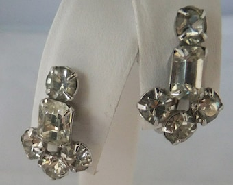 Vintage jewelry earring by Coro Art Deco style in clear rhinestones set in silver tone with screw backs Sale half price