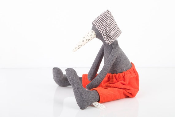 Dark gray wool Penguin with white dotted beak wearing  black and white checkered hat and neon  orange corduroy pants -handmade fabric doll