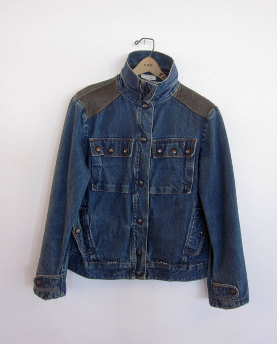 vintage 80's distressed denim jean jacket with brass snap buttons pop up collar leather detailing motorcycle retro men's
