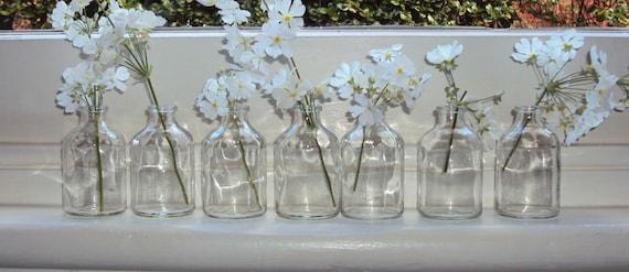 Seven upcycled mini bottles.Great for weddings resturants.