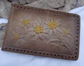 Old French leather cover photo album with edelweiss flowers