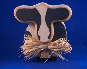Black and Cream Wooden Cow
