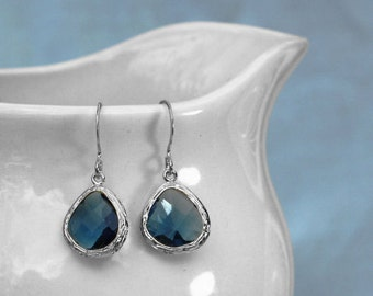 navy blue earrings with silver plated bezel setting. Framed and faceted