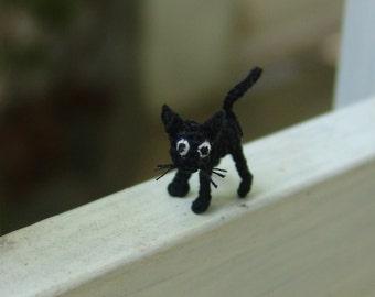 tiny crochet ugly black cat
