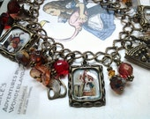 Red Earth Pinkaline Alice In Wonderland Charms Bracelet in Antique Bronze