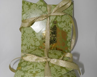 Christmas gift box set with ribbon, tags and coordinating tissue wrap.