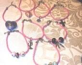 Pink leather charmed bracelets