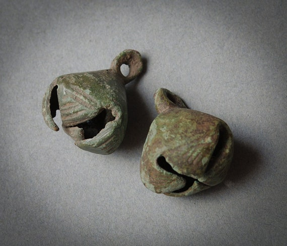 Pair of antique brass jingle bells. Black parina of time.