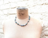 SALE: Fremantle Collection necklace - blue cambodian paper beads knotted with a twist