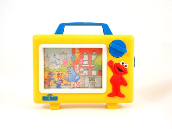 Sesame Street Musical Toys : Vintage sesame street musical toy rolling television
