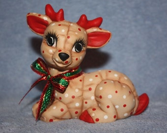 Handpainted Ceramic Christmas Reindeer Baby painted with a Holly Berry print to look stuffed and a plaid ribbon