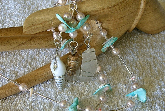 Sea glass necklace with pink pearls and shells. Sea glass jewelry.