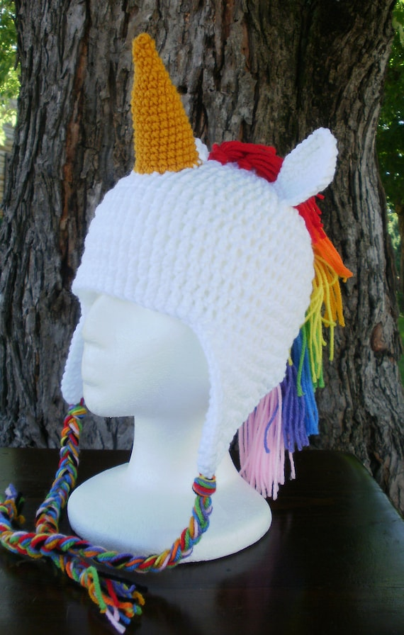 Magical Unicorn Hat Knitting Pattern (6 mo. size, see PDF for other sizes) This pattern is copyright Little Red Window Design and is intended for personal use. You may not not distribute, reproduce or sell this pattern either physically or digitally.