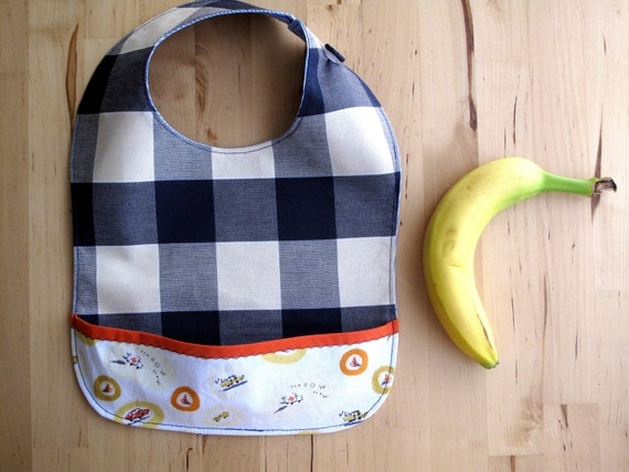 Toddler bib extra wide. Super soft, absorbant and resistant bib. Big checkers, white stripes and blue on the back. Ready to ship.